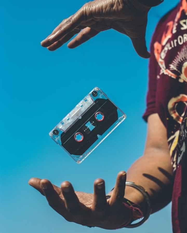 person doing tricks on cassette tape