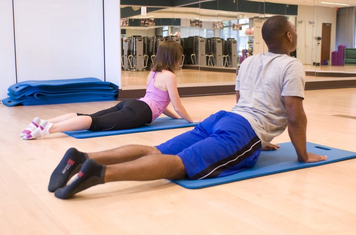 15406-a-man-and-woman-working-out-in-a-fitness-center-pv